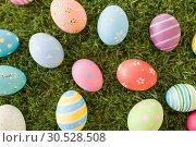 Купить «colored easter eggs on artificial grass», фото № 30528508, снято 15 марта 2018 г. (c) Syda Productions / Фотобанк Лори