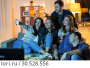 Купить «happy friends taking selfie by smartphone at home», фото № 30528556, снято 22 декабря 2018 г. (c) Syda Productions / Фотобанк Лори