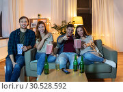 Купить «friends with beer and popcorn watching tv at home», фото № 30528592, снято 22 декабря 2018 г. (c) Syda Productions / Фотобанк Лори