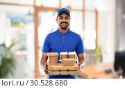 Купить «indian delivery man with food and drinks at office», фото № 30528680, снято 12 января 2019 г. (c) Syda Productions / Фотобанк Лори