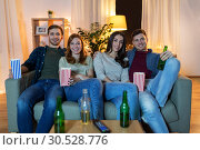 Купить «friends with beer and popcorn watching tv at home», фото № 30528776, снято 22 декабря 2018 г. (c) Syda Productions / Фотобанк Лори