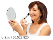 Купить «senior woman with mirror and make up blush brush», фото № 30528820, снято 8 февраля 2019 г. (c) Syda Productions / Фотобанк Лори