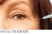 Купить «close up of senior woman face and syringe», фото № 30528828, снято 8 февраля 2019 г. (c) Syda Productions / Фотобанк Лори
