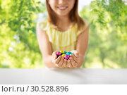 Купить «close up of girl holding chocolate easter eggs», фото № 30528896, снято 25 июля 2018 г. (c) Syda Productions / Фотобанк Лори