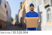 Купить «happy indian delivery man with parcel box in city», фото № 30528904, снято 12 января 2019 г. (c) Syda Productions / Фотобанк Лори