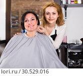 Купить «Adult woman likes very much her hairdress», фото № 30529016, снято 7 марта 2017 г. (c) Яков Филимонов / Фотобанк Лори