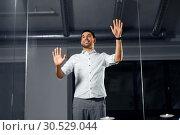 Купить «businessman touching glass wall at night office», фото № 30529044, снято 25 января 2019 г. (c) Syda Productions / Фотобанк Лори