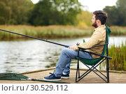 Купить «bearded fisherman with fishing rod at lake», фото № 30529112, снято 8 сентября 2018 г. (c) Syda Productions / Фотобанк Лори