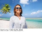 Купить «happy smiling woman in sunglasses over beach», фото № 30529204, снято 15 июня 2018 г. (c) Syda Productions / Фотобанк Лори