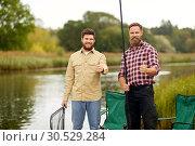 Купить «happy friends with fishing rods showing thumbs up», фото № 30529284, снято 8 сентября 2018 г. (c) Syda Productions / Фотобанк Лори