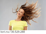 Купить «happy young woman with waving long hair», фото № 30529288, снято 29 января 2019 г. (c) Syda Productions / Фотобанк Лори