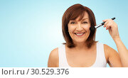 Купить «smiling senior woman with make up blush brush», фото № 30529376, снято 8 февраля 2019 г. (c) Syda Productions / Фотобанк Лори