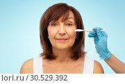 Купить «senior woman and surgeon hands with scalpel», фото № 30529392, снято 8 февраля 2019 г. (c) Syda Productions / Фотобанк Лори