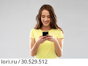 Купить «young woman or teenage girl using smartphone», фото № 30529512, снято 29 января 2019 г. (c) Syda Productions / Фотобанк Лори