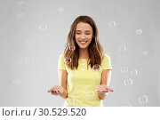young woman or teenage gir with soap bubbles. Стоковое фото, фотограф Syda Productions / Фотобанк Лори