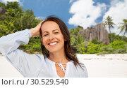 Купить «happy smiling woman on summer beach», фото № 30529540, снято 15 июня 2018 г. (c) Syda Productions / Фотобанк Лори
