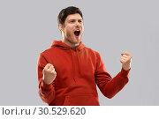 Купить «happy man celebrating and making fist pump gesture», фото № 30529620, снято 3 февраля 2019 г. (c) Syda Productions / Фотобанк Лори