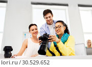 photographers with camera at photo studio. Стоковое фото, фотограф Syda Productions / Фотобанк Лори