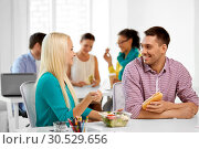 Купить «happy colleagues having lunch and eating at office», фото № 30529656, снято 17 мая 2014 г. (c) Syda Productions / Фотобанк Лори
