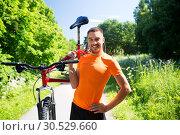 Купить «happy young man with bicycle outdoors in summer», фото № 30529660, снято 5 июля 2015 г. (c) Syda Productions / Фотобанк Лори
