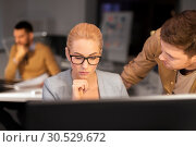 Купить «business team with computer working late at office», фото № 30529672, снято 26 ноября 2017 г. (c) Syda Productions / Фотобанк Лори
