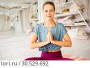 Купить «woman meditating in lotus pose at yoga studio», фото № 30529692, снято 21 июня 2018 г. (c) Syda Productions / Фотобанк Лори