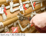 Купить «Plumber at work», фото № 30530512, снято 23 апреля 2010 г. (c) Tryapitsyn Sergiy / Фотобанк Лори