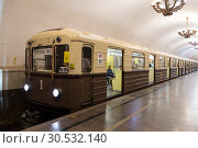 "Купить «A retro-train ""Sokolniki"", stylized as the first train of the Moscow metro. Moscow metro in honor of its 83rd anniversary holds a ""train Parade"" on the ring line of the Moscow metro. Moscow. Russia», фото № 30532140, снято 12 мая 2018 г. (c) Наталья Волкова / Фотобанк Лори"