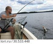 Pike fishing. Lake Amanningen. Sweden. (2016 год). Редакционное фото, фотограф Andre Maslennikov / age Fotostock / Фотобанк Лори