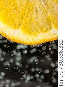 Купить «Juicy orange slice», фото № 30536352, снято 13 февраля 2011 г. (c) Tryapitsyn Sergiy / Фотобанк Лори