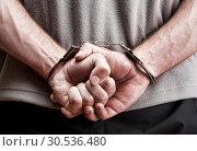 Criminal in handcuffs. Стоковое фото, фотограф Tryapitsyn Sergiy / Фотобанк Лори