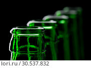 Row of open green beer bottles. Стоковое фото, фотограф Tryapitsyn Sergiy / Фотобанк Лори