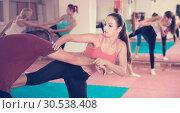 Купить «Female is training self-defence moves in pair with trainer in sporty gym.», фото № 30538408, снято 8 октября 2017 г. (c) Яков Филимонов / Фотобанк Лори