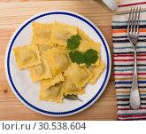 Купить «Delicious appetizing ravioli with bay leaf and black pepper», фото № 30538604, снято 22 августа 2019 г. (c) Яков Филимонов / Фотобанк Лори