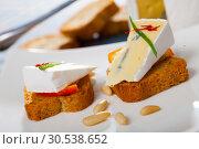 Купить «Canapes with soft blue cheese and orange», фото № 30538652, снято 23 июля 2019 г. (c) Яков Филимонов / Фотобанк Лори