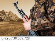 Купить «Soldier holding rifle AK-47», фото № 30539728, снято 11 апреля 2013 г. (c) Tryapitsyn Sergiy / Фотобанк Лори