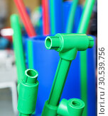 Купить «Polymer pipes and fittings», фото № 30539756, снято 22 апреля 2013 г. (c) Tryapitsyn Sergiy / Фотобанк Лори