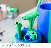 Купить «Polymer pipes and fittings», фото № 30539832, снято 22 апреля 2013 г. (c) Tryapitsyn Sergiy / Фотобанк Лори