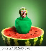 Купить «Funny man with watermelon helmet and googles», фото № 30540576, снято 19 сентября 2013 г. (c) Tryapitsyn Sergiy / Фотобанк Лори