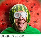 Купить «Funny man with watermelon helmet and googles», фото № 30540584, снято 19 сентября 2013 г. (c) Tryapitsyn Sergiy / Фотобанк Лори