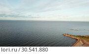 Купить «View from the drone on the sandy beach and the coast of the Gulf of Finland, on the horizon the districts of St. Petersburg», видеоролик № 30541880, снято 9 апреля 2009 г. (c) Куликов Константин / Фотобанк Лори