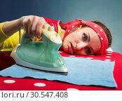 Купить «Tired housewife with ironing-board», фото № 30547408, снято 7 декабря 2013 г. (c) Tryapitsyn Sergiy / Фотобанк Лори