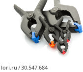 Plastic clamps on white background. Стоковое фото, фотограф Tryapitsyn Sergiy / Фотобанк Лори