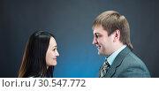Купить «Two young business people talking and discussing», фото № 30547772, снято 6 февраля 2014 г. (c) Tryapitsyn Sergiy / Фотобанк Лори