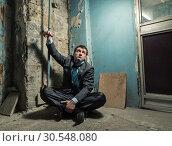 Arrested man with handcuffed hand. Стоковое фото, фотограф Tryapitsyn Sergiy / Фотобанк Лори