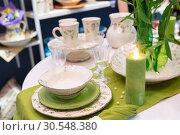 Купить «Served fashion green table with glases and plates», фото № 30548380, снято 29 мая 2014 г. (c) Tryapitsyn Sergiy / Фотобанк Лори