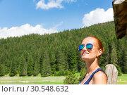 Купить «Woman with sunglasses in forest», фото № 30548632, снято 12 июня 2014 г. (c) Tryapitsyn Sergiy / Фотобанк Лори