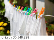 Купить «Cloth with colorful pins», фото № 30548828, снято 10 июня 2014 г. (c) Tryapitsyn Sergiy / Фотобанк Лори