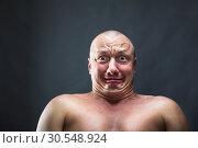 Купить «Portrait of bald scared man», фото № 30548924, снято 23 июля 2014 г. (c) Tryapitsyn Sergiy / Фотобанк Лори