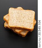 Купить «Heap of toasted bread slices», фото № 30549104, снято 5 сентября 2014 г. (c) Tryapitsyn Sergiy / Фотобанк Лори